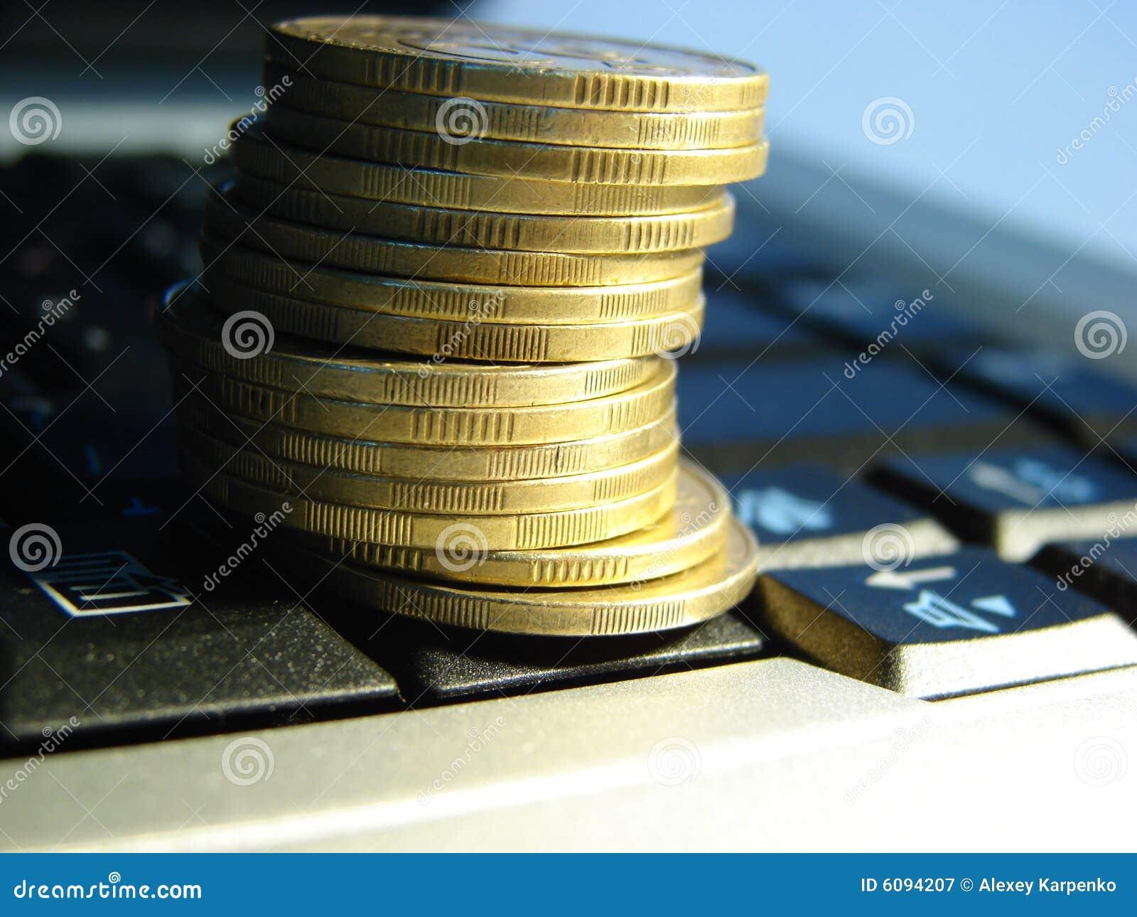 Złote monety laptop