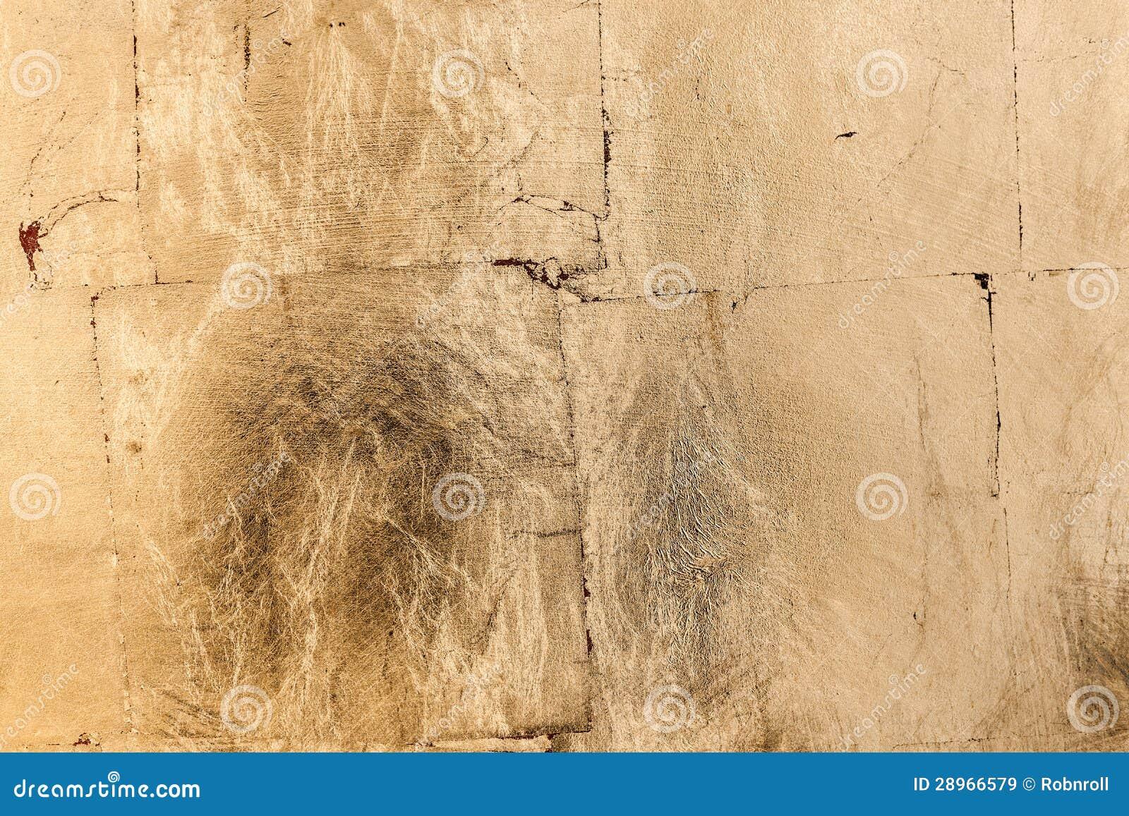 Złotego brązu grunge barwiona tekstura lub tło