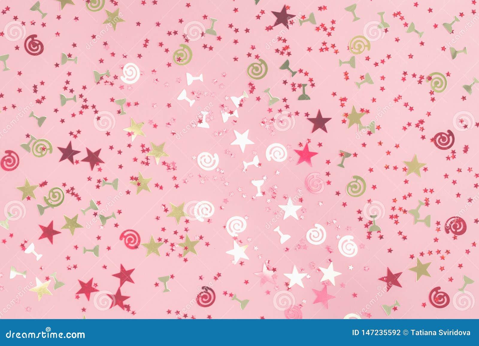 Złotego lśnienia asortowani świąteczni confetti na menchiach