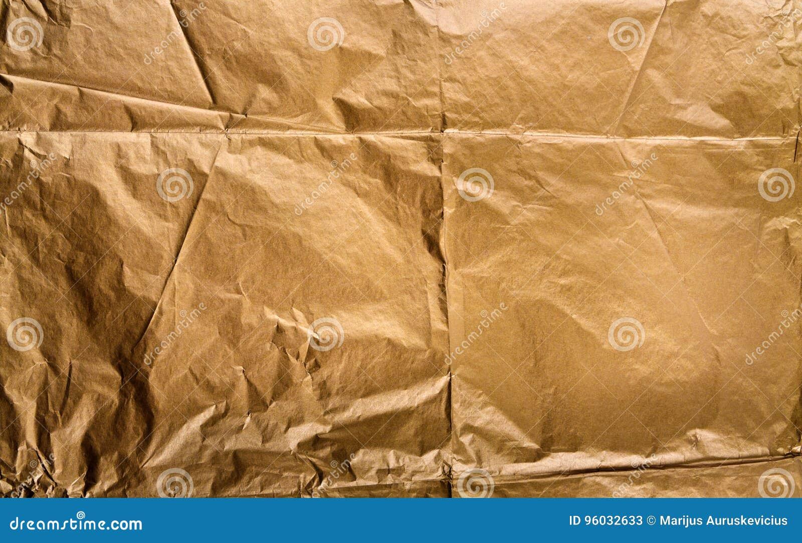 Złoty papierowy tekstury tło