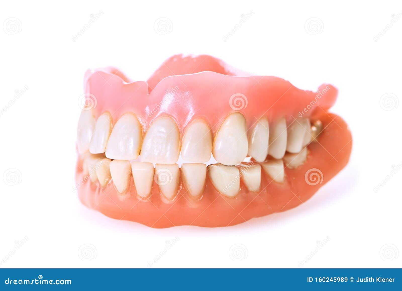 Zahnprothesen Auf Weißem Hintergrund Stockbild - Bild von