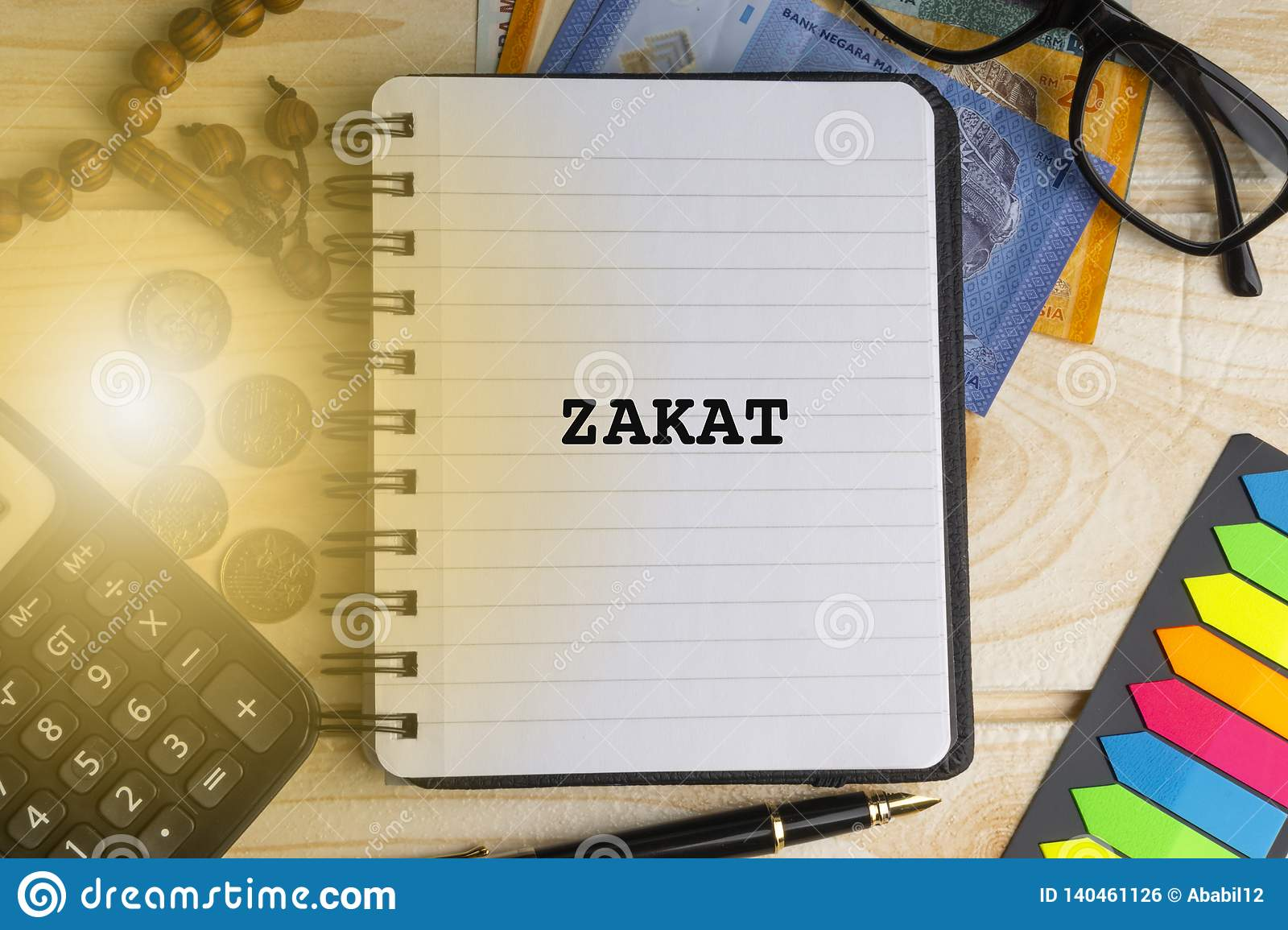458 zakat photos free royalty free stock photos from dreamstime https www dreamstime com zakat islamic tax inscription written book calculator rosary coins banknotes book eyeglasses pen wooden background image140461126