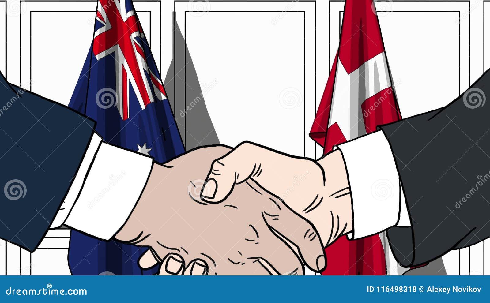 Zakenlieden of politicischokhanden tegen vlaggen van Australië en Denemarken Officiële verwante vergadering of samenwerking