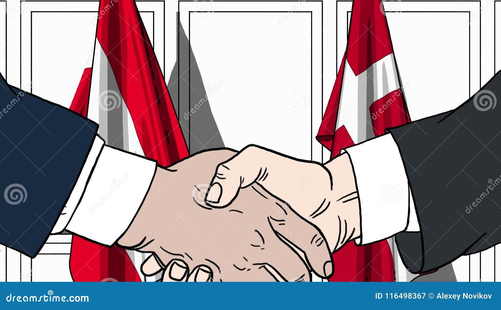 Zakenlieden of politicischokhanden tegen vlaggen van Oostenrijk en Denemarken Officiële verwante vergadering of samenwerking