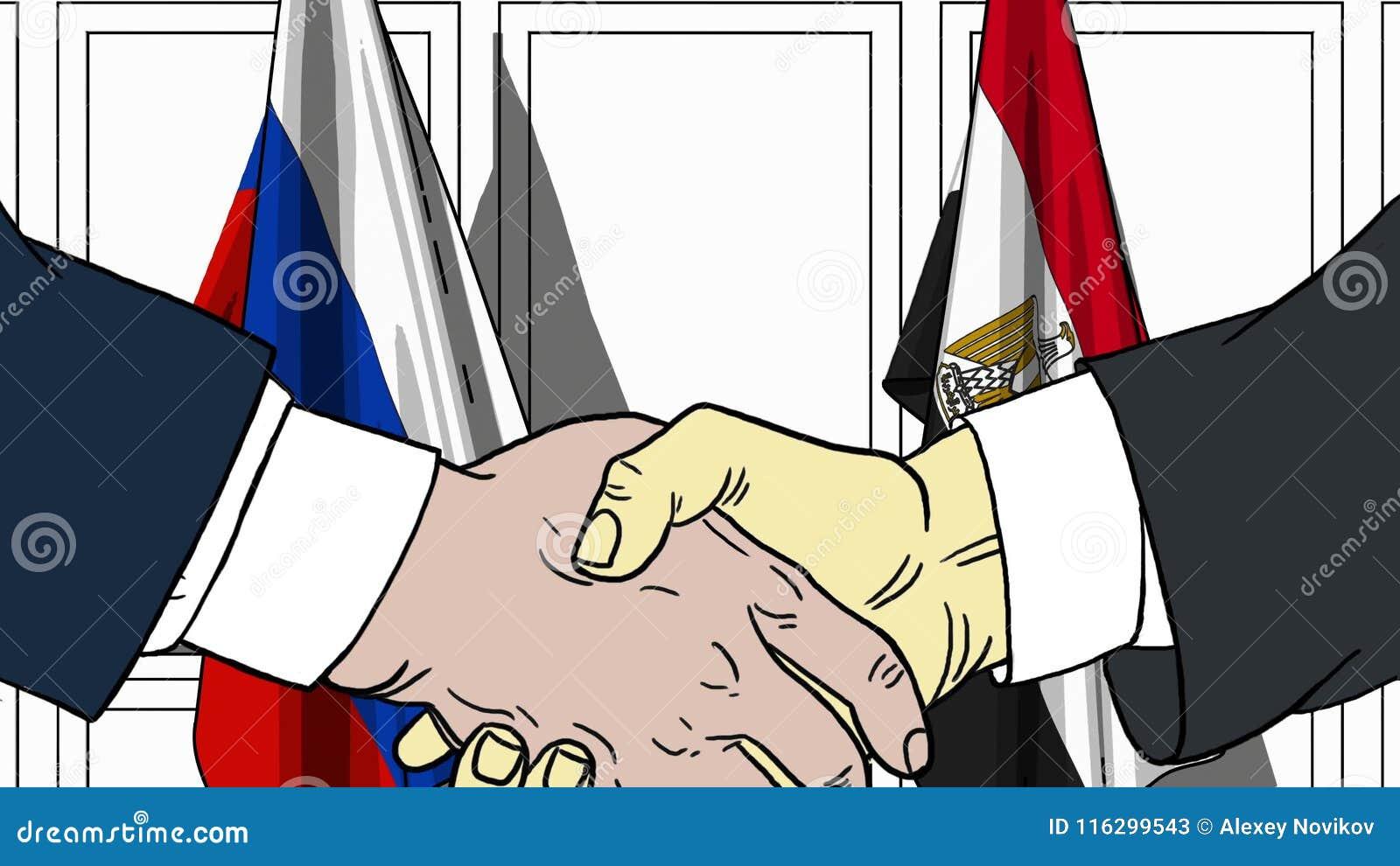 Zakenlieden of politicischokhanden tegen vlaggen van Rusland en Egypte Officiële verwante vergadering of samenwerking