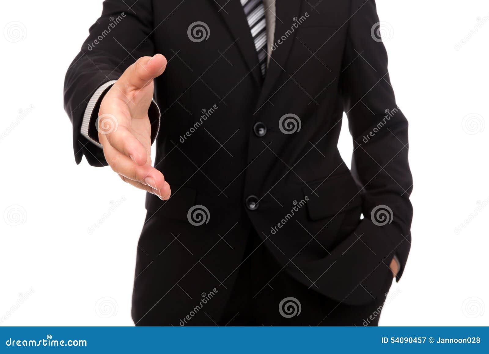 Zakenman die voor handdruk aanbiedt