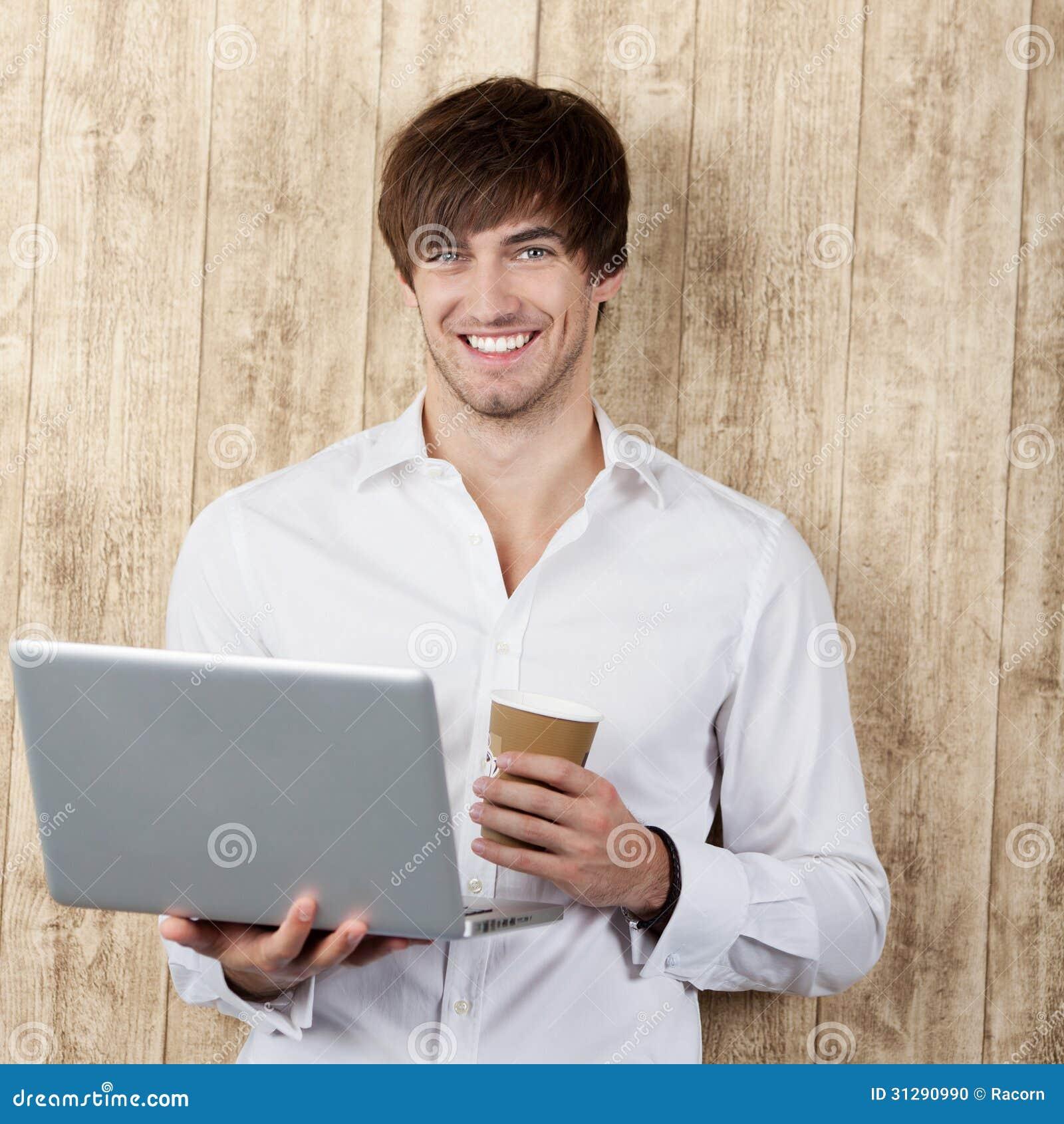 Zakenman With Disposable Cup en Laptop