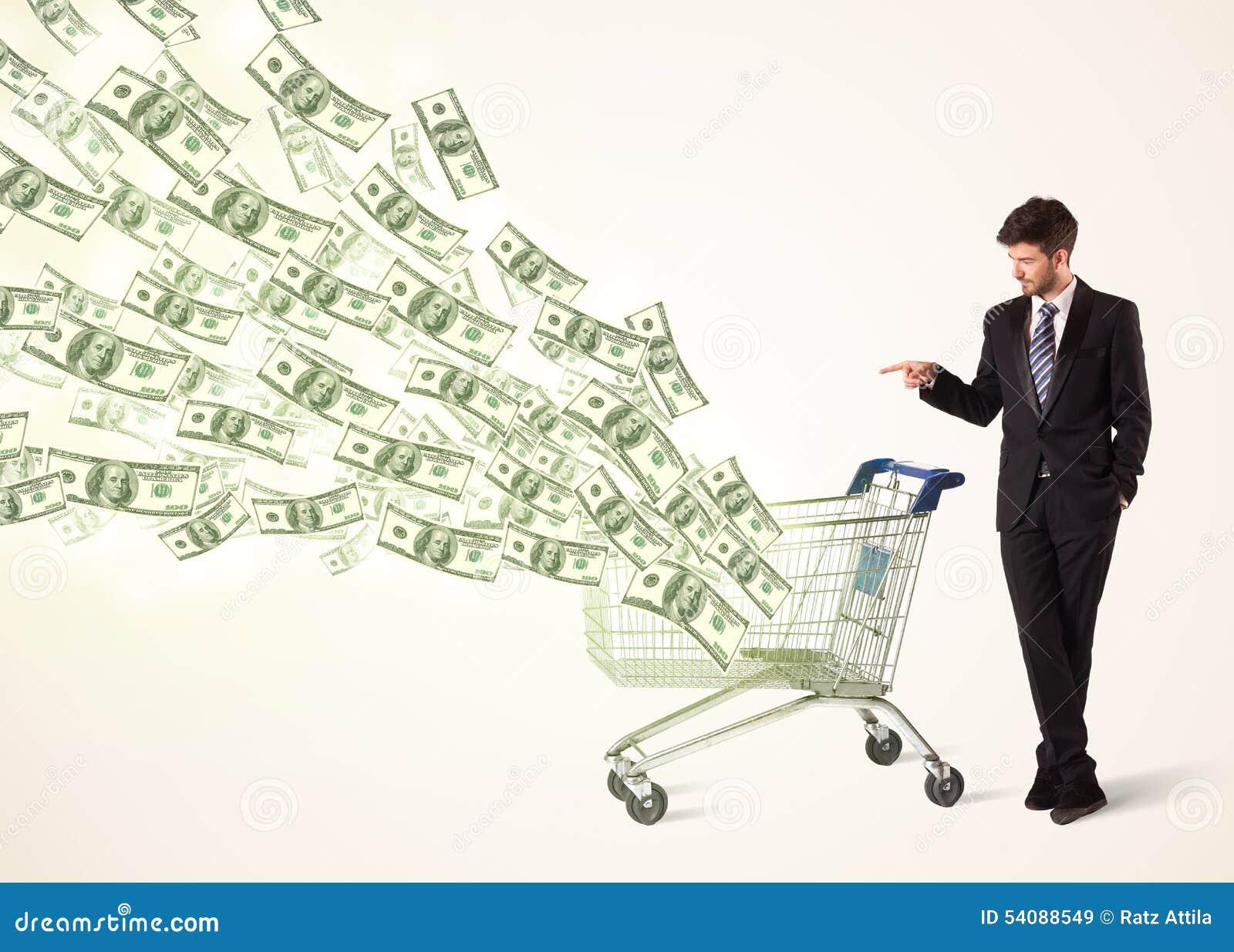 Zakenman met boodschappenwagentje met dollarrekeningen