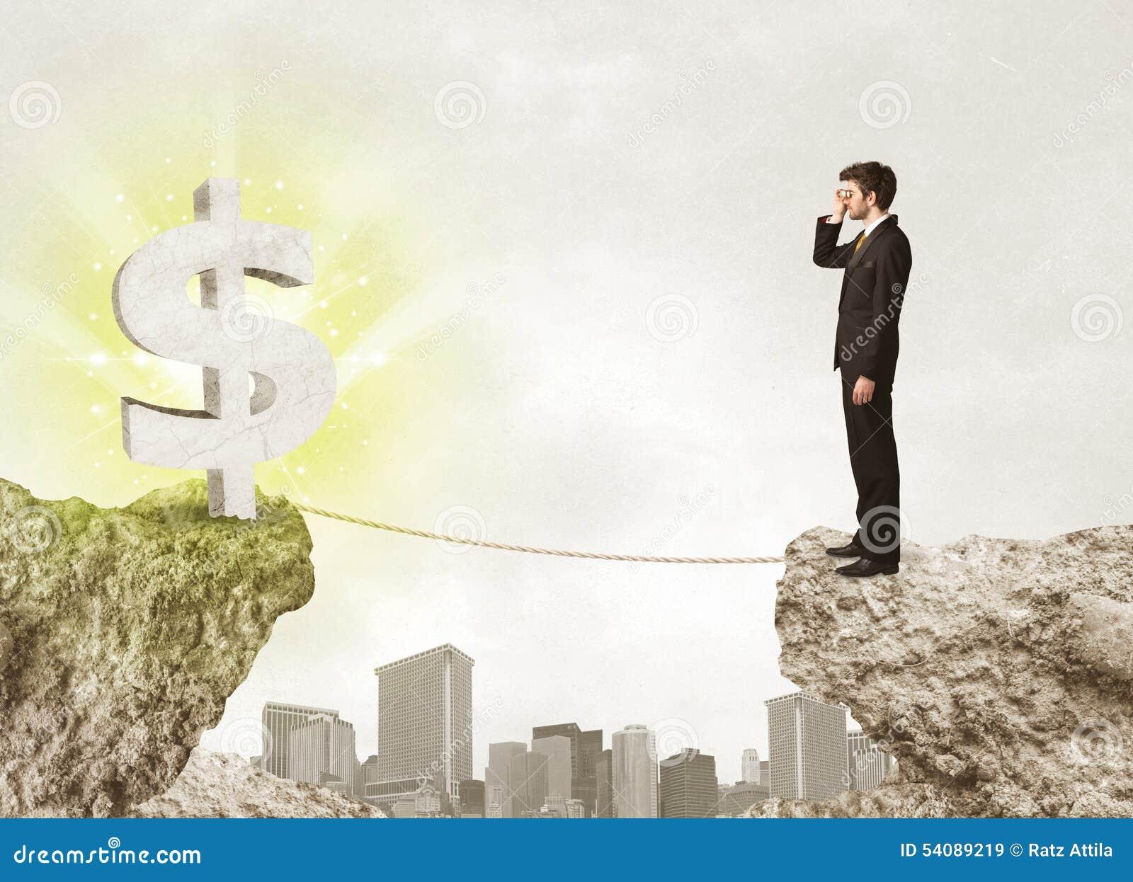 Zakenman op rotsberg met een dollarteken