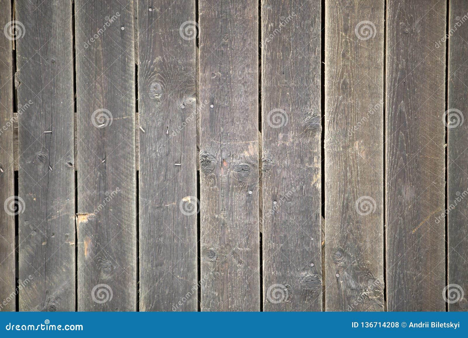 Zakończenie naturalny stary rocznik wietrzejąca szara brown unpainted stała drewniana brama lub ogrodzenie deski i deski ekologic