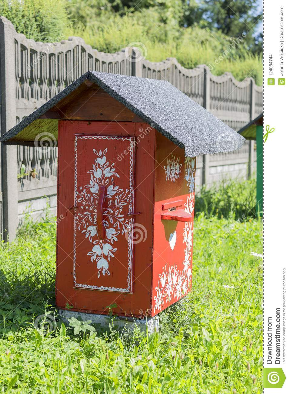 Old wooden beehives decorated with a hand painted colorful flowers, Zalipie, Poland