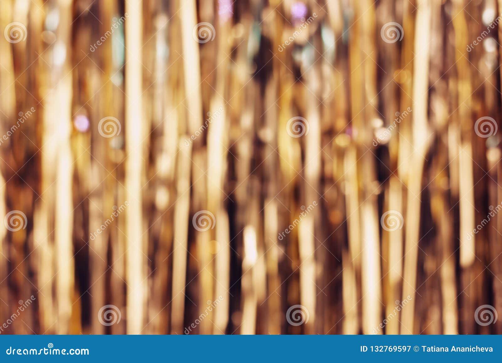 Zamazany złoty świecidełko obdziera, boże narodzenie dekoracji tło