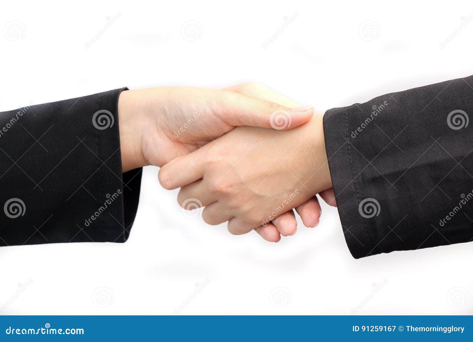 Zamyka up dwa biznesowej kobiety trząść rękę