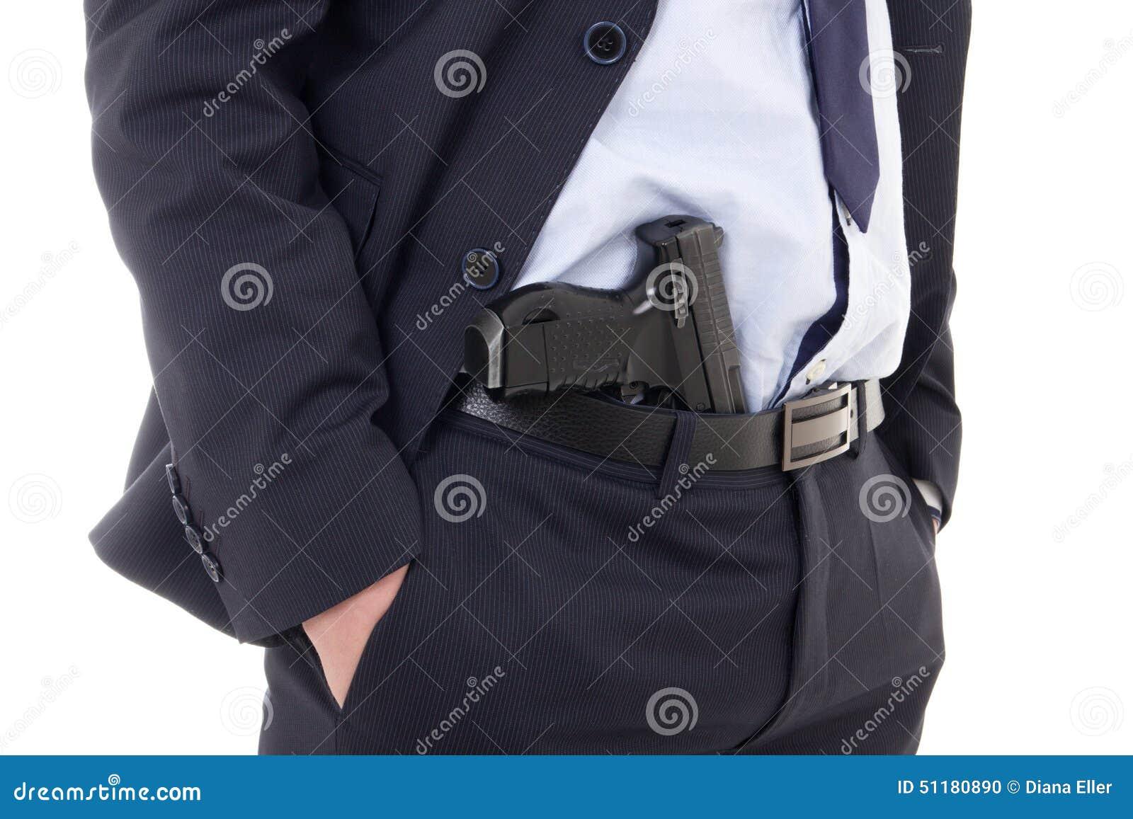 Zamyka up pistolet w policjancie lub ochroniarz dyszy odosobnionego na whit