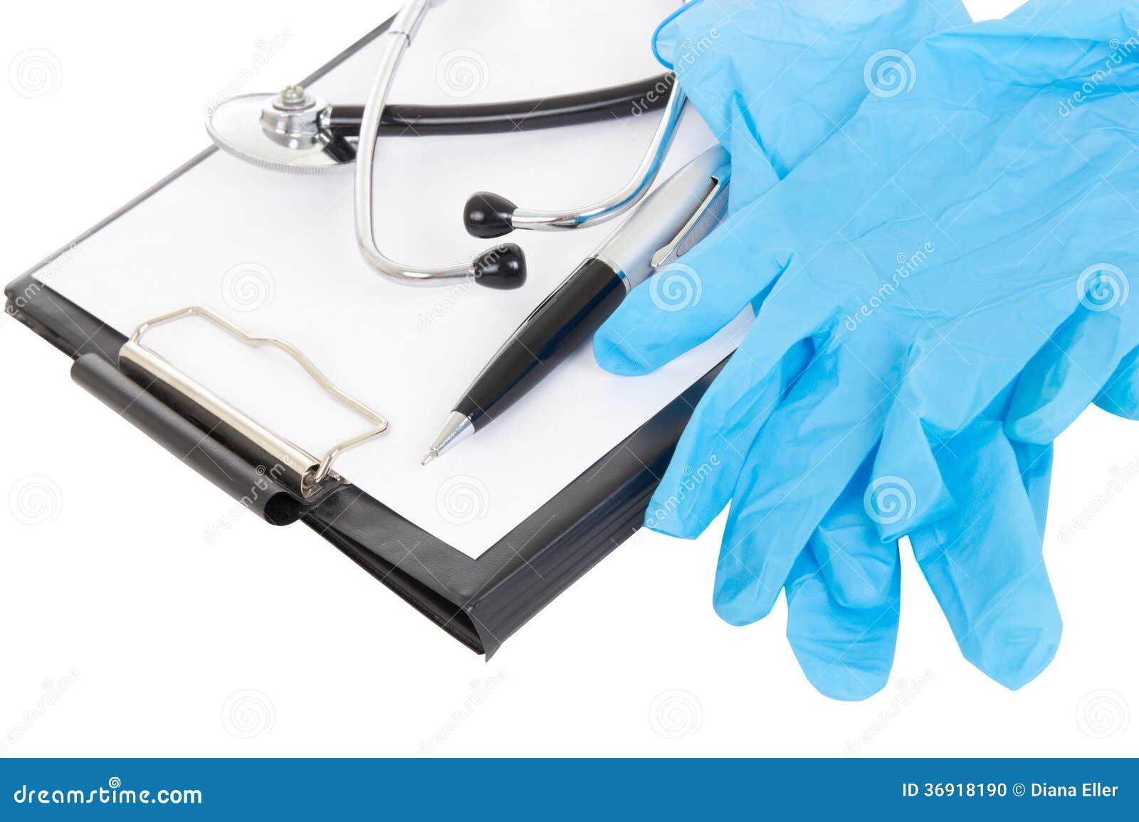 Zamyka up plastikowy schowek, pióro, gumowe rękawiczki i stethoscop,