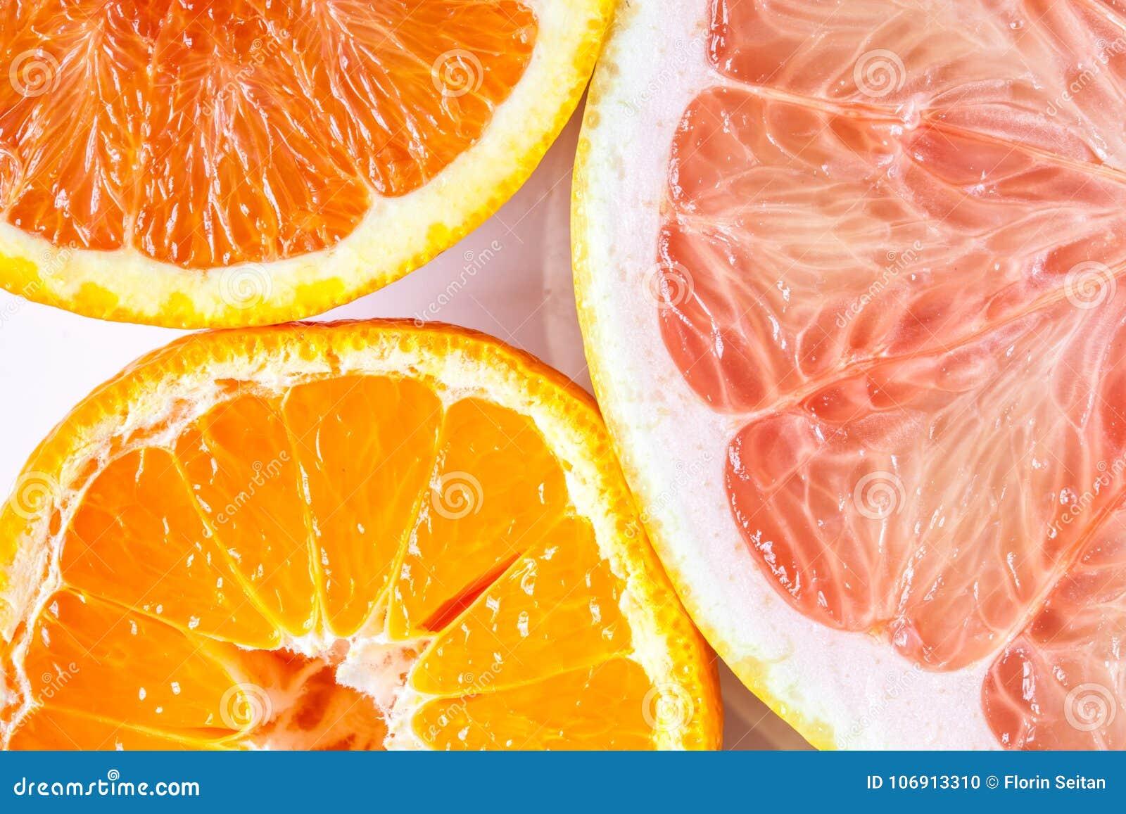 Zamyka up różnorodne cytrus owoc pomarańcze, mandarynka i grapefruitowy -,