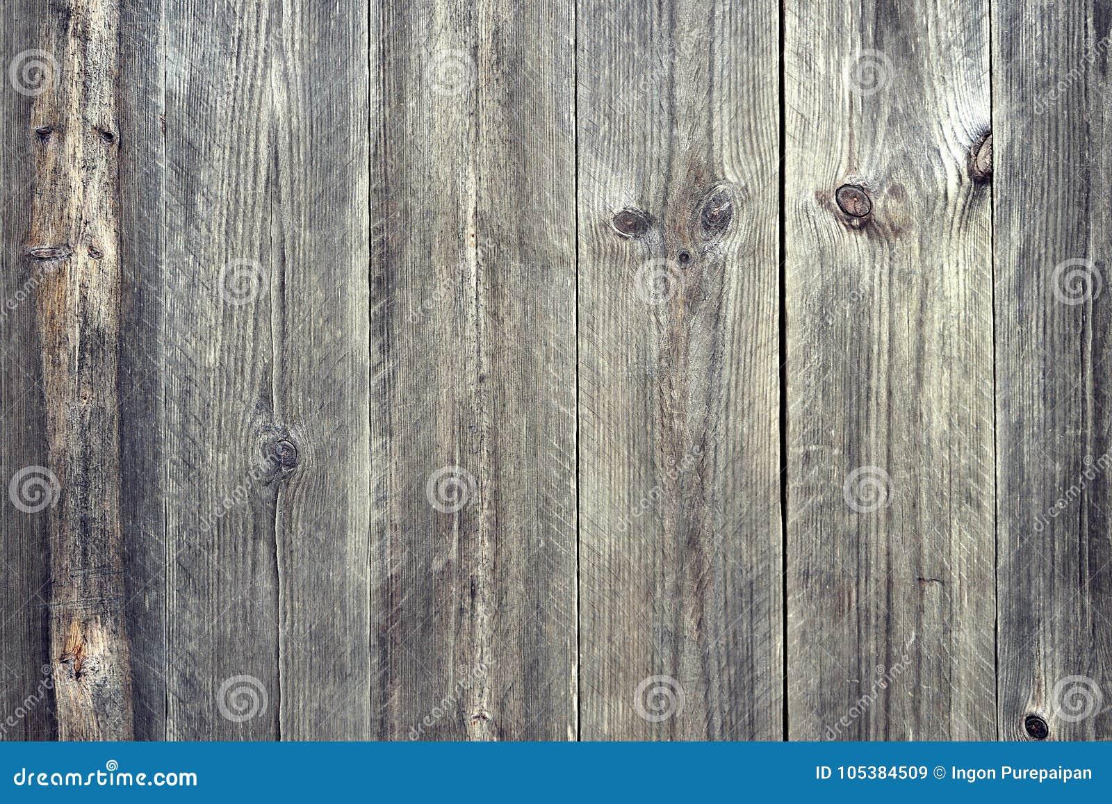 Zamyka w górę ciemnego brązu Drewnianych desek, tło zmroku starzy panel