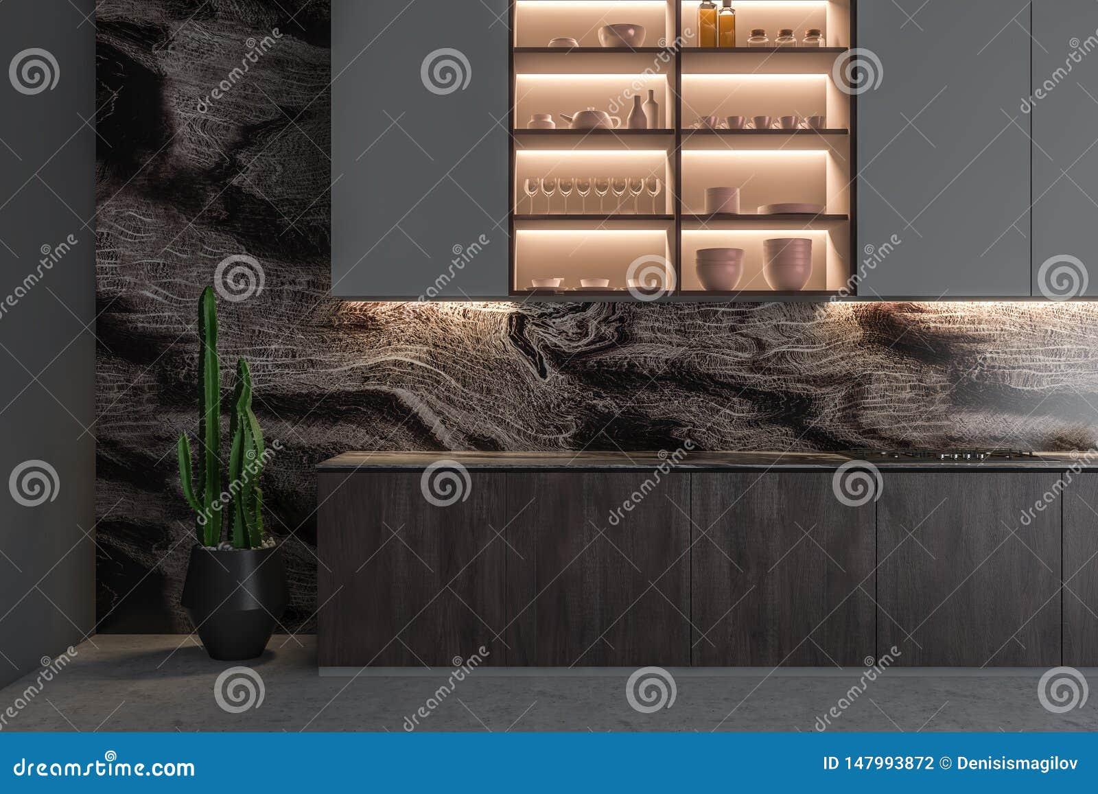 Zamyka w górę szarego kuchennego wnętrza z półkami