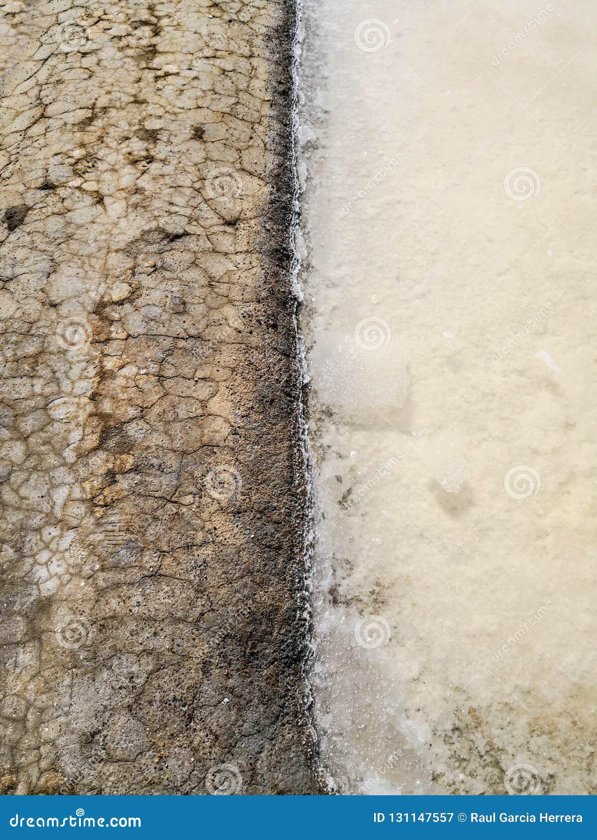 Zamyka w górę Tradycyjnego saltworks Isla Cristina, Huelva, Hiszpania Deponuje cedziny, kanały i borowinowych mieszkania,