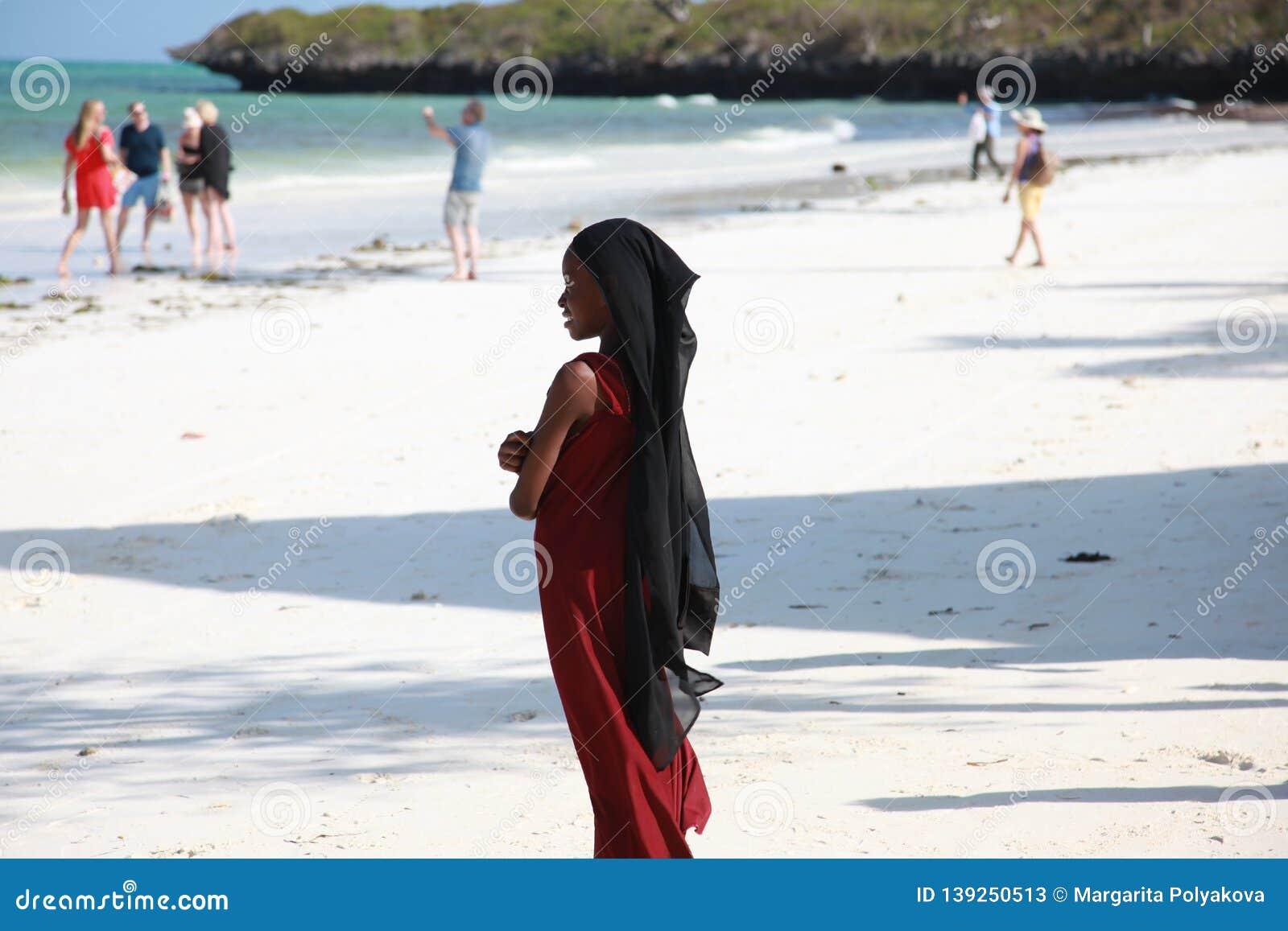 African Young Girls On A Street Of Zanzibar Island