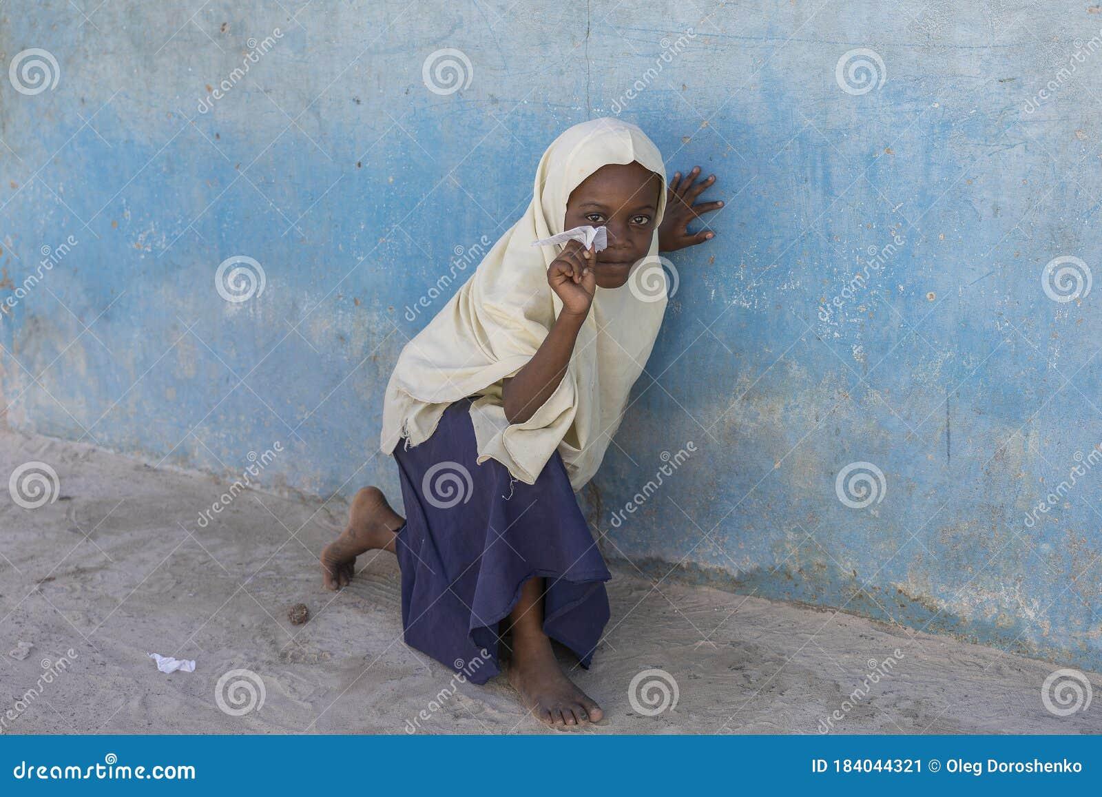 Tanzania, Zanzibar Island, portrait of girl lying on the