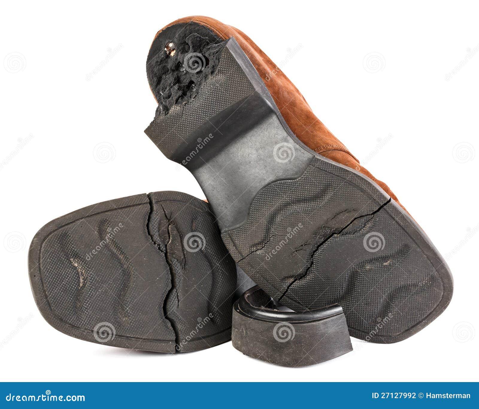 e723e7de Zapatos Rotos Viejos Con La Planta Del Pie Agrietada Foto de archivo ...