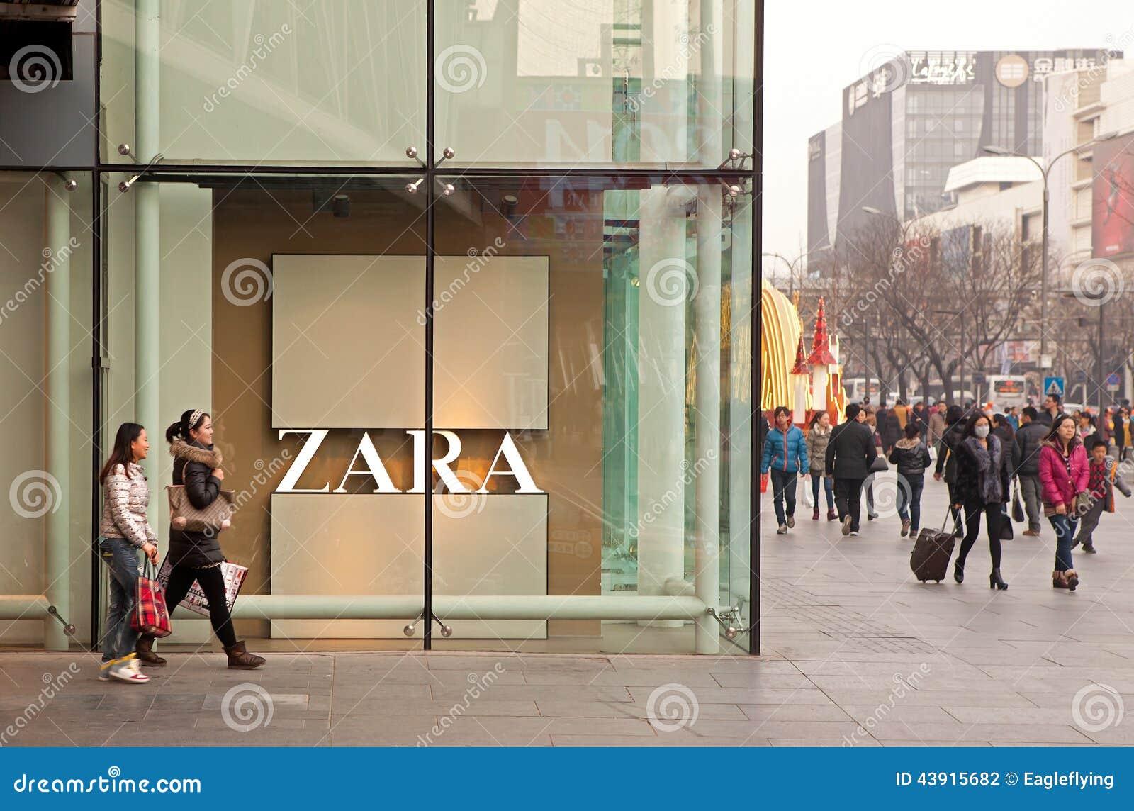 BEIJING, CHINA - JANUARY 2, 2014: People is seen around a Zara store