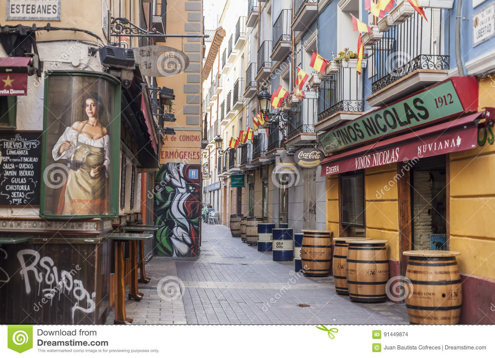d66e8cc849f5 Typical street in El tubo,famous area in the city, tapas food, Zaragoza.