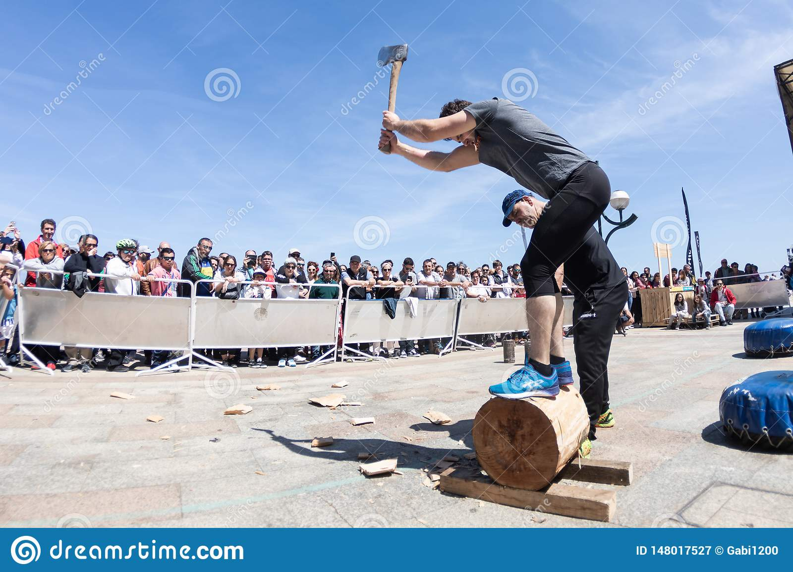 Zarautz, Gipuzcoa / Spain - May 12 2019: Wood chopping demostration in basque country