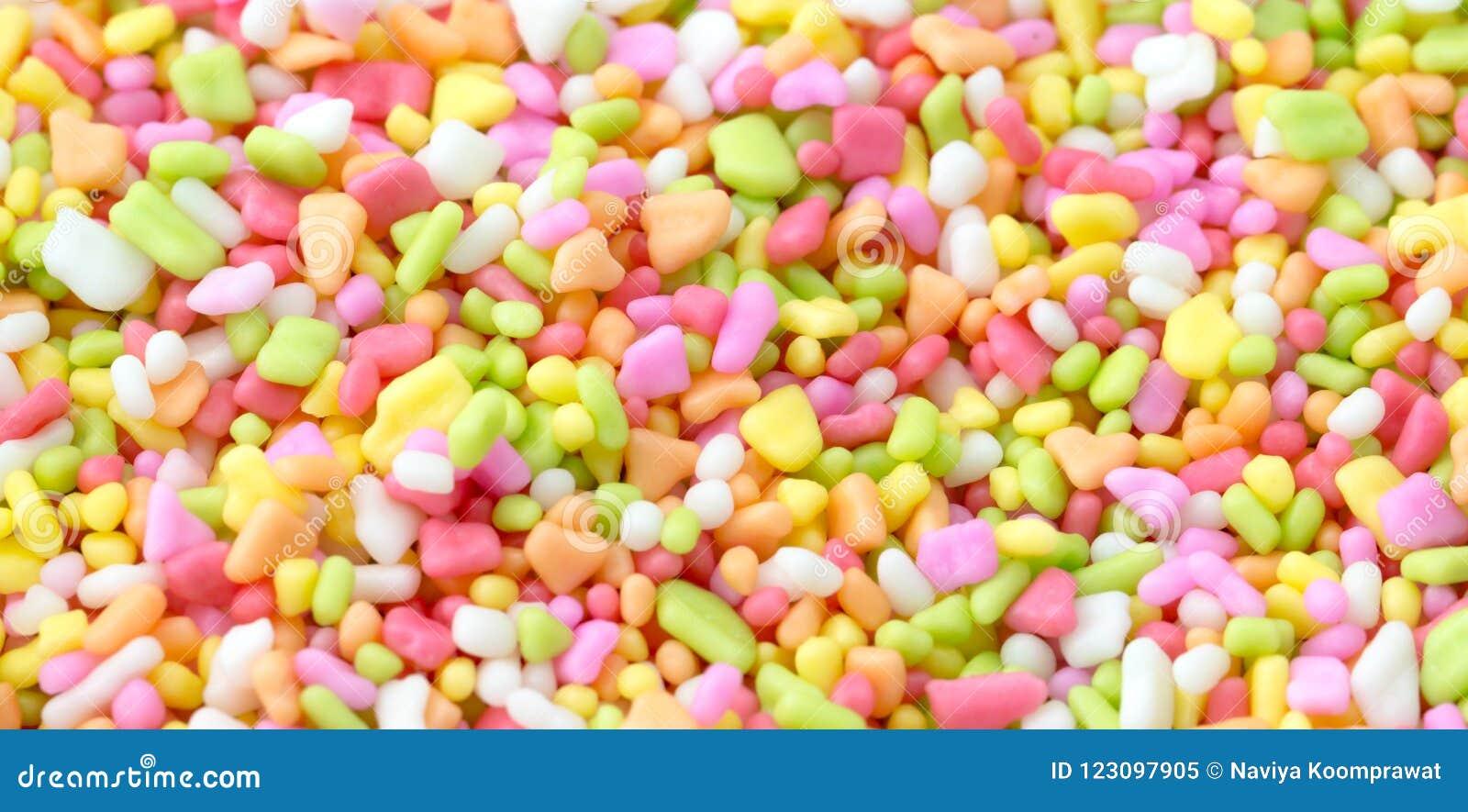 Zbliżenie kolorowa słodka polewa dla piekarni tła