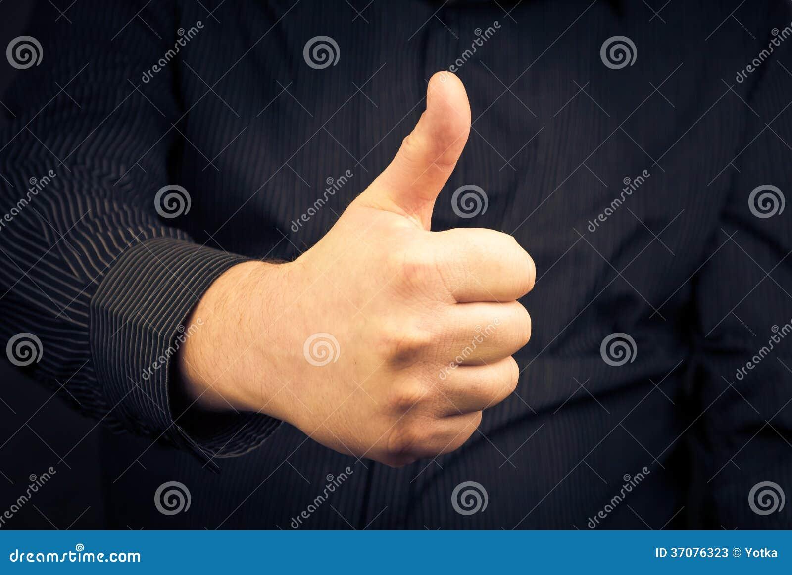 Download Zbliżenie Mężczyzna Ręka Pokazuje Kciuk Obraz Stock - Obraz złożonej z postura, język: 37076323