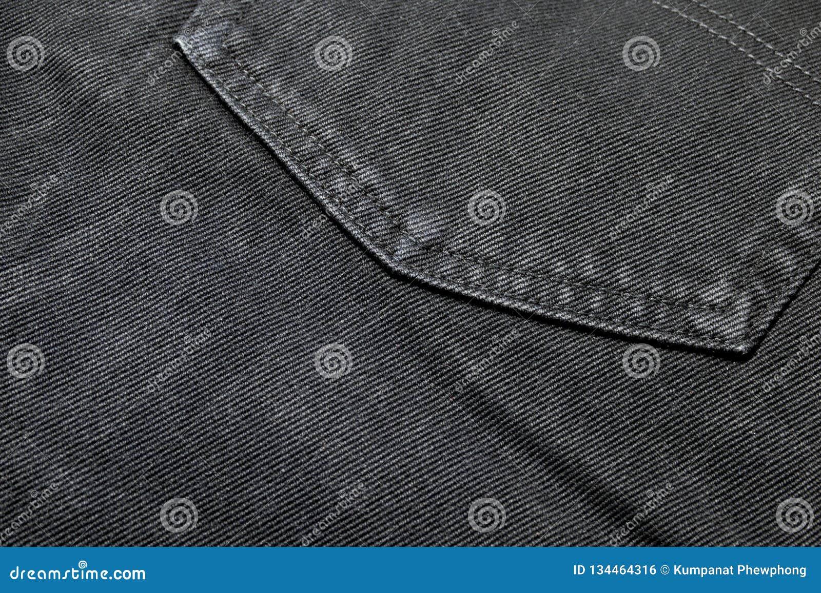 Zbliżenie tekstura plecy kieszeni czerni drelichu cajgi