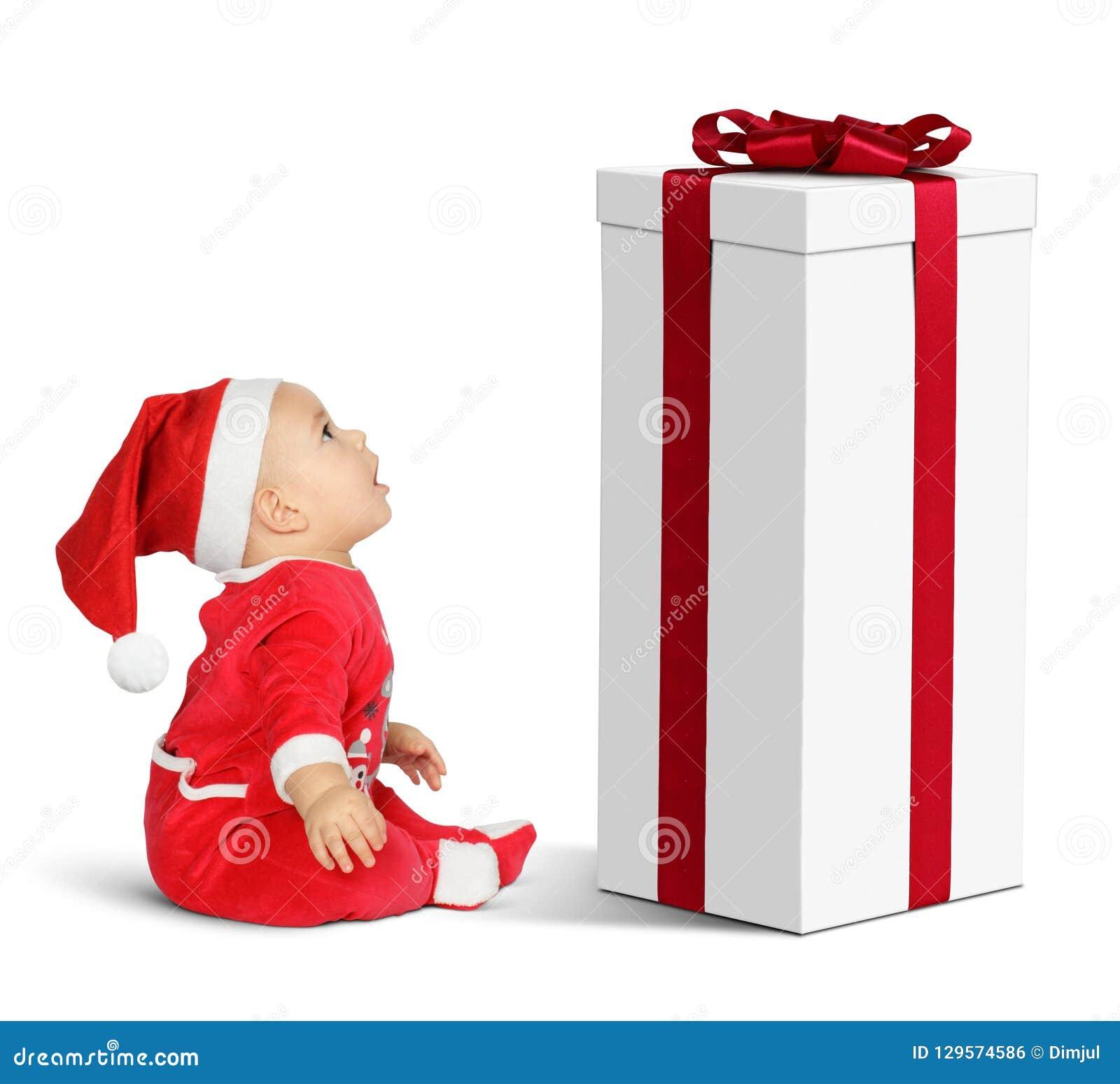 Zdziwiony Mały dziecko Święty Mikołaj z dużym Bożenarodzeniowym prezentem jako gn,