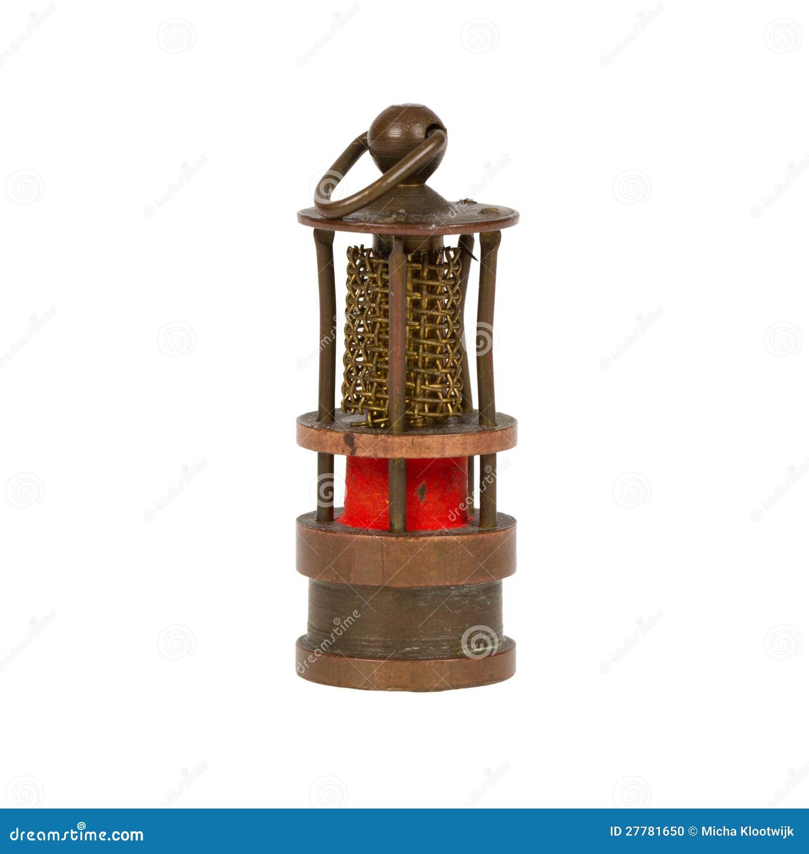 Zeer oude miniatuur van een mijnwerkerslamp