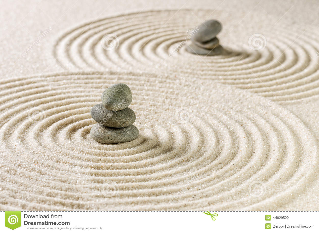 Zen garden with stacked stones and sand with circles stock for Garden designs with stone circles