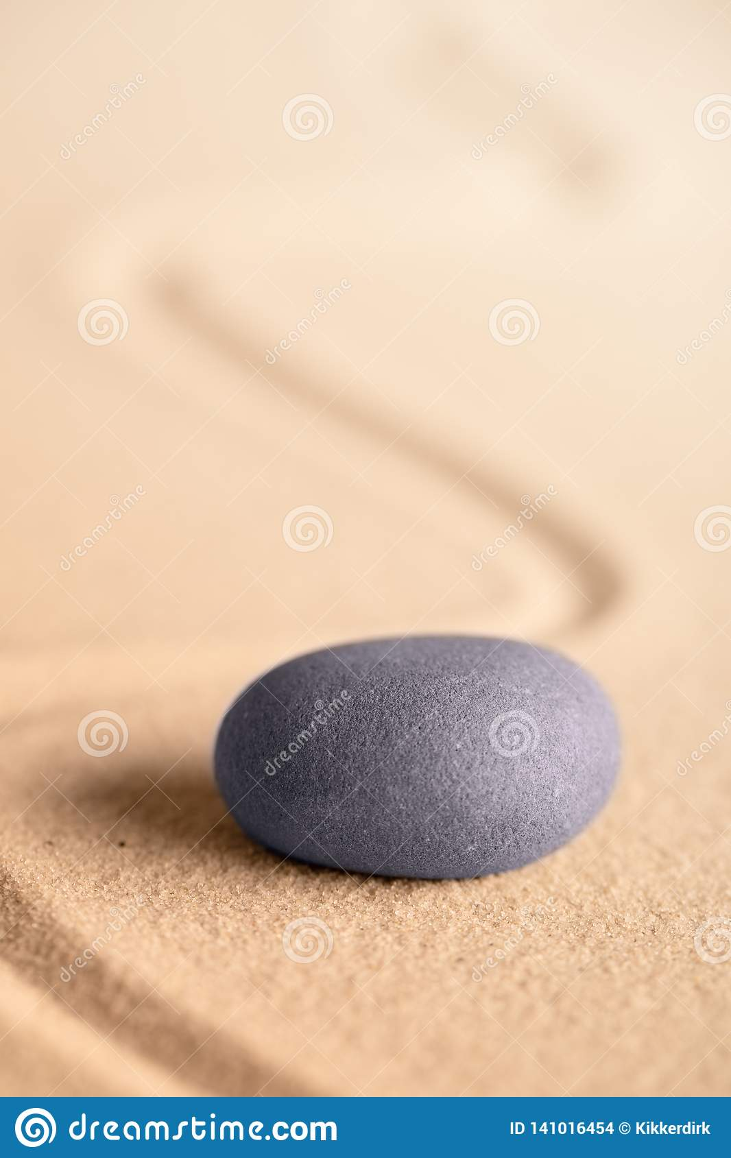Zen meditation stone in a Japanese garden with raked sand