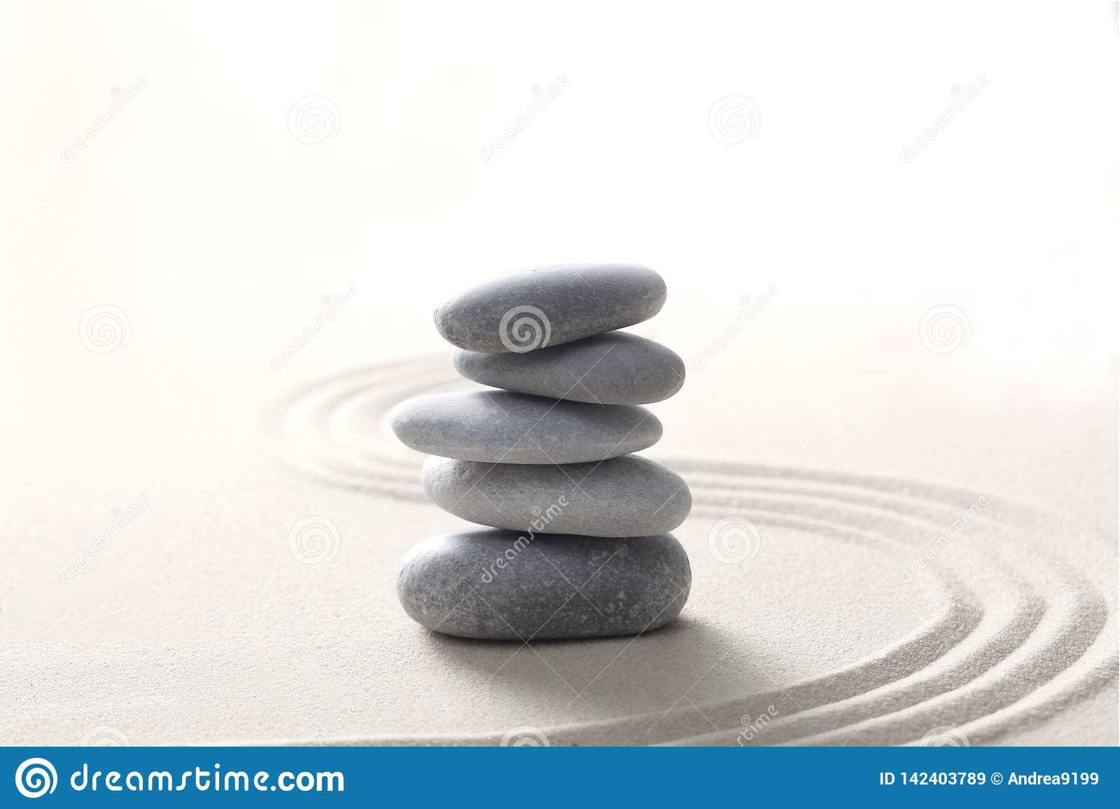 Zen Stone Concept Grey Stones Piled On The Sand With Copy Space