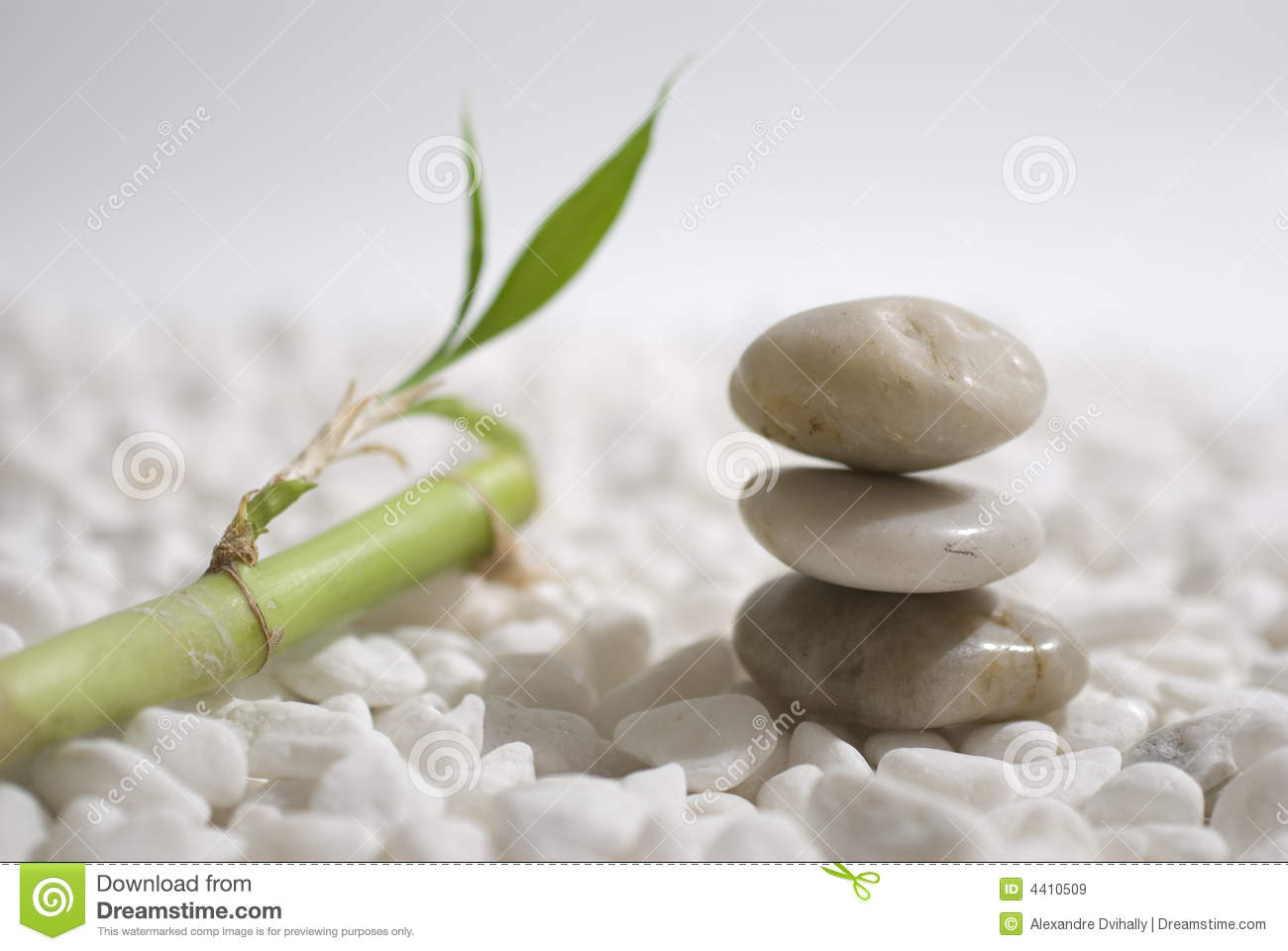 Zen stones and bamboo on white pebbles background - meditation concept ...