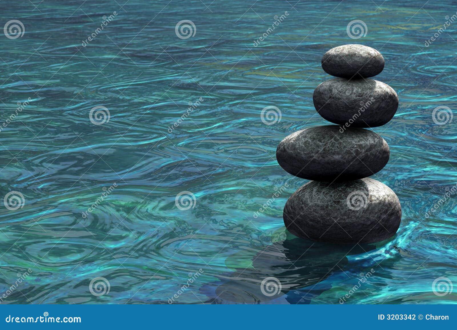 Zen stones stacked on river scene