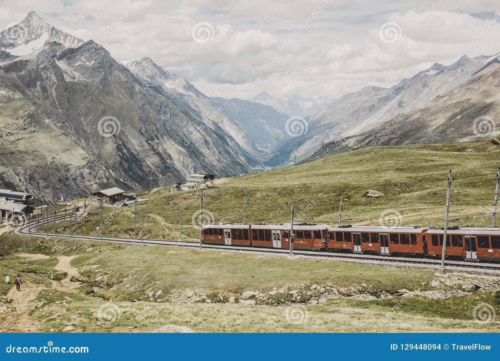 Gornergrat train with tourist is going to Matterhorn mountain