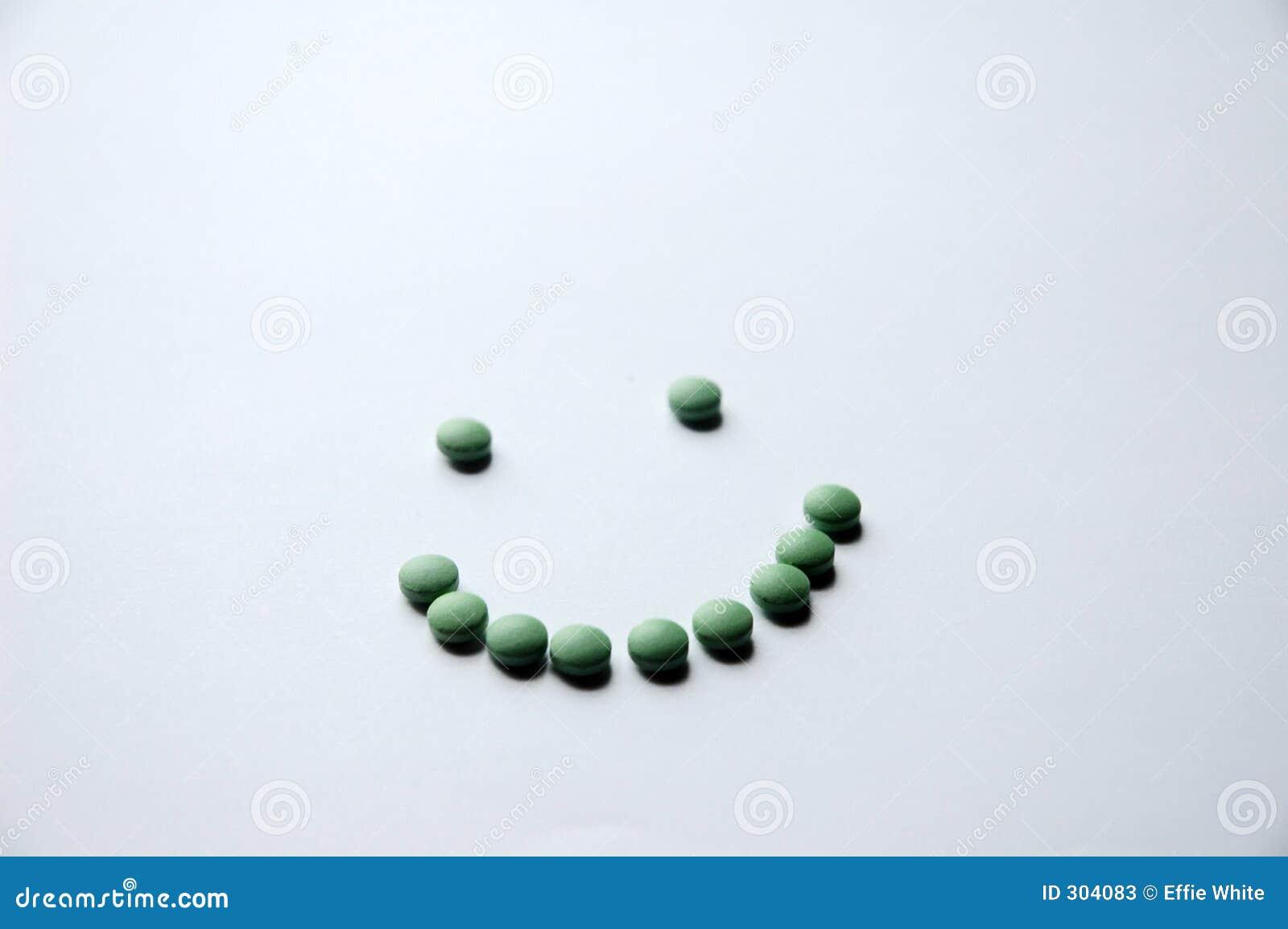 Zielony pigułka uśmiech