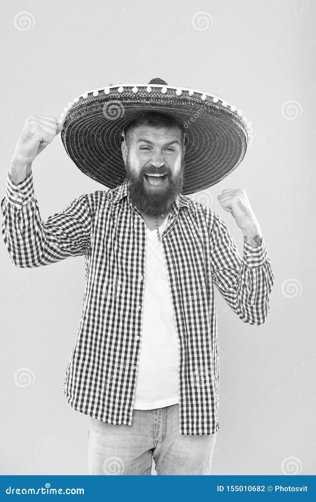 Zijn hartstocht is aan partij Mexicaanse mens die sombrero dragen Hipster in brede randhoed Gebaarde mens in Mexicaanse hoed trad