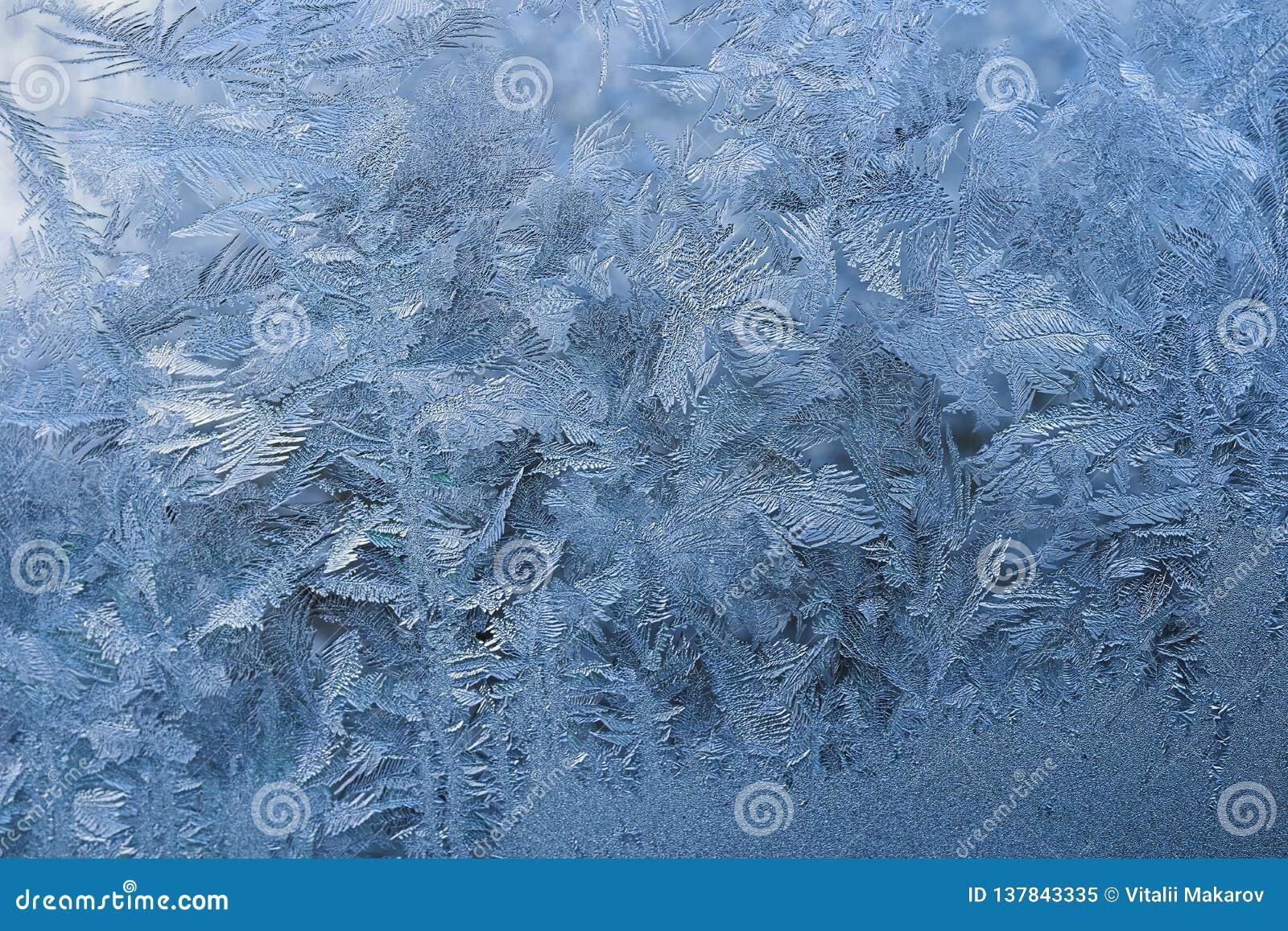 Zima wzór lodowi kryształy na szkle