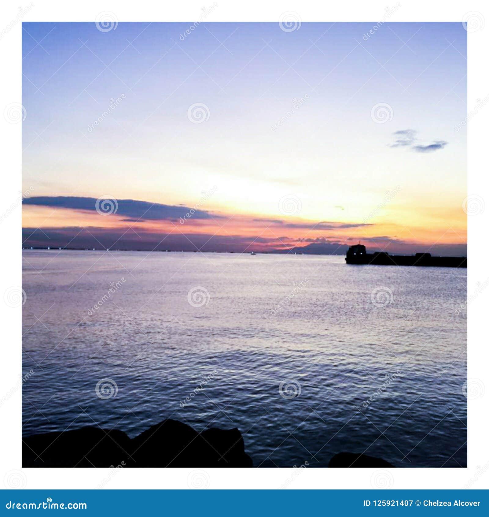 Zmierzch przy Manila zatoką