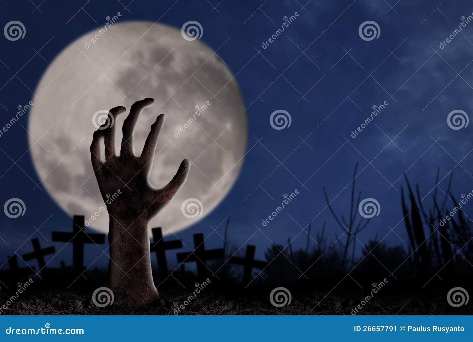 Zombie hand on graveyard