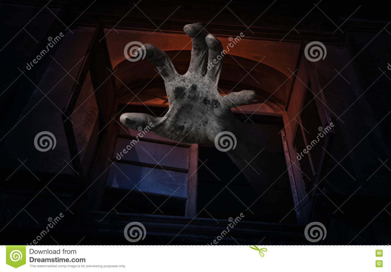 Zombie hand rising out from old ancient window, Spooky background, Halloween concept