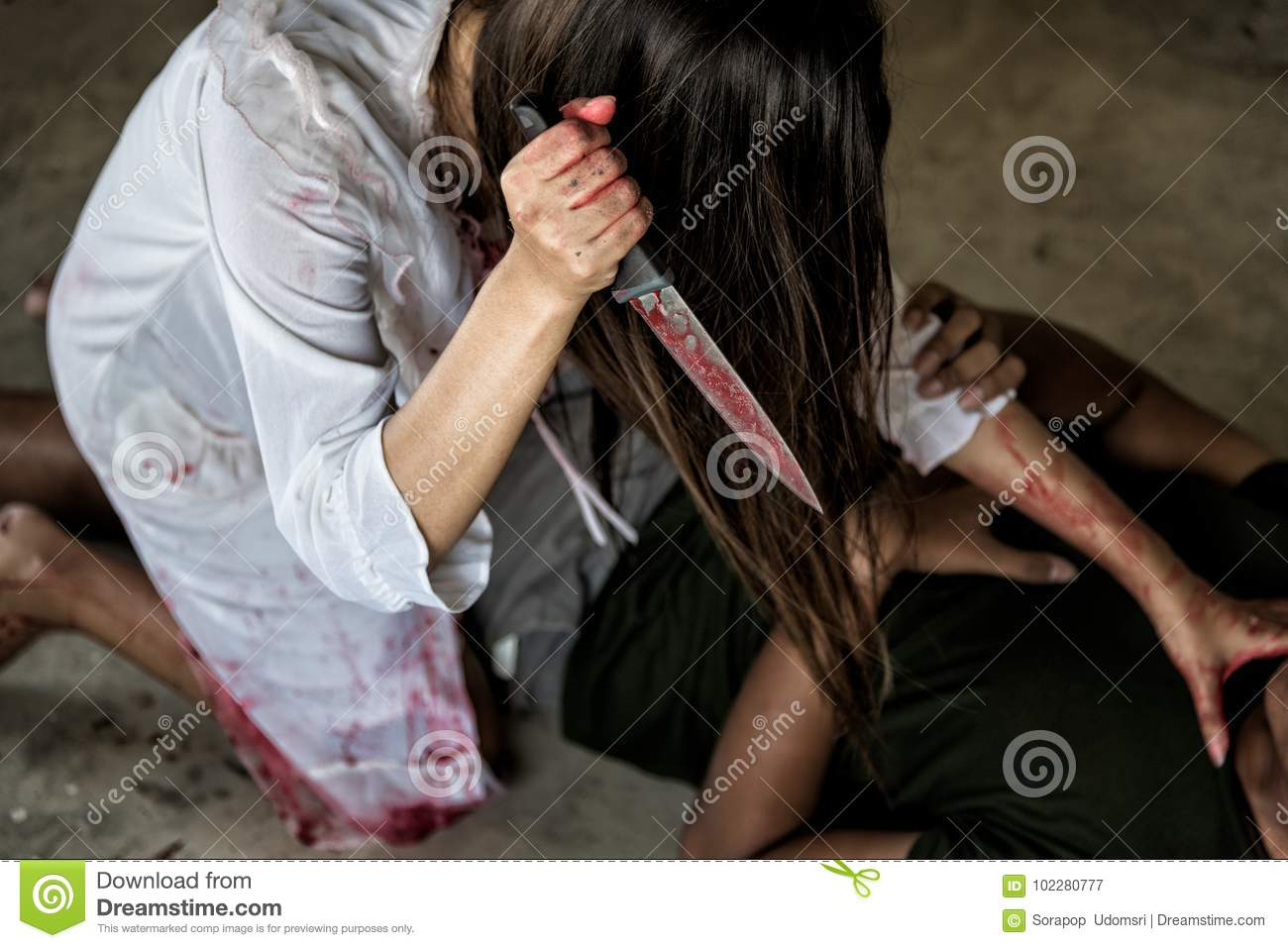 Zombie woman or Woman Ghost holding knife will kill man people