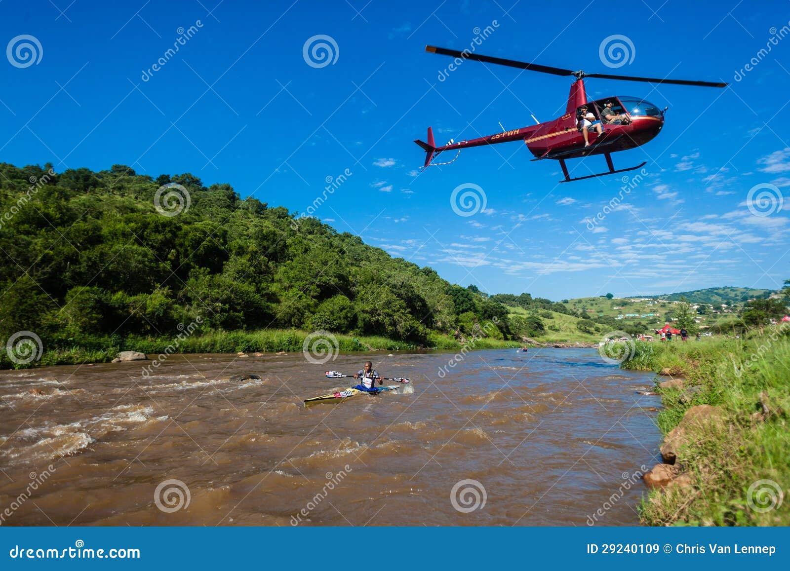 Download Zondi Conduz A Raça Da Canoa Do Helicóptero Imagem de Stock Editorial - Imagem de media, paddlers: 29240109