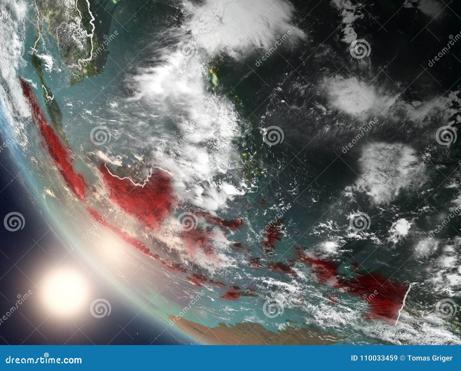 Zonsondergang boven Indonesië van ruimte