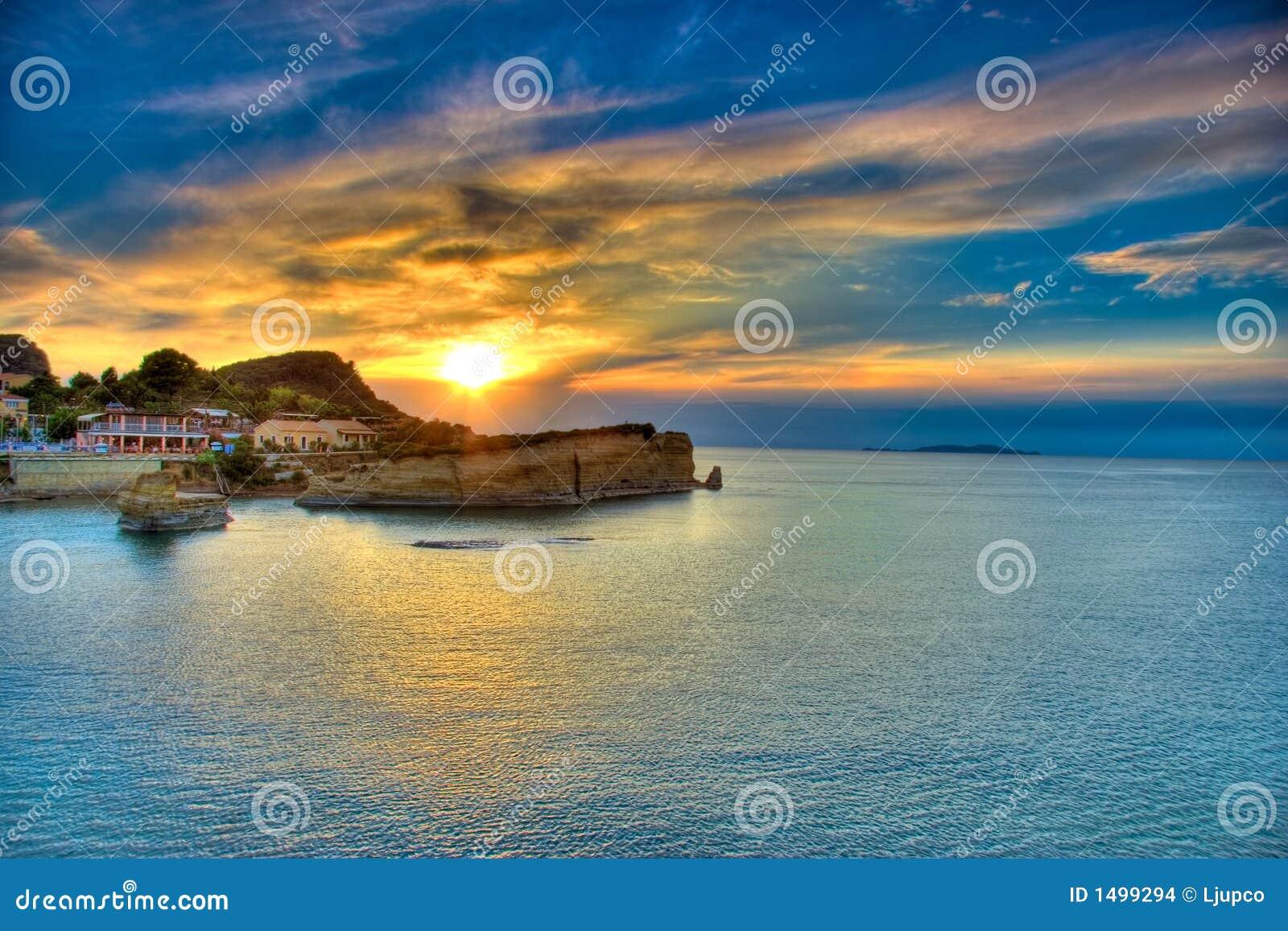 Citaten Over Zonsondergang : Zonsondergang over het eiland van korfu stock afbeeldingen